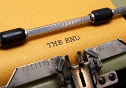 """paper in typewriter reads """"THE END"""""""