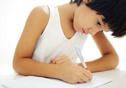 boy writing on paper