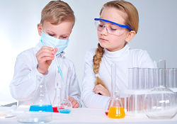 two children doing science experiments