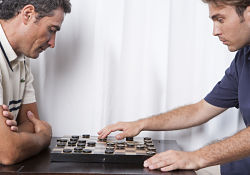 two men playing a board game