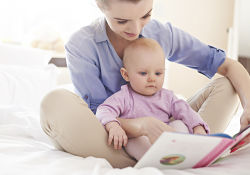mother and baby reading a book