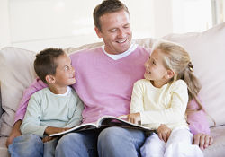 man reading story to children
