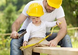 boy and father in construction hats