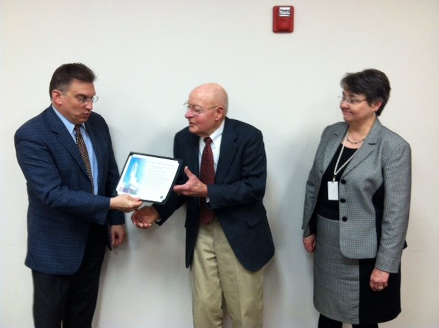 John Sieck, center, is congratulated for 18 years of book deliveries to Messiah Village by Cumberland County Commissioner Gary Eichelberger, left, and Jonelle Darr, executive director of Cumberland County Library System.