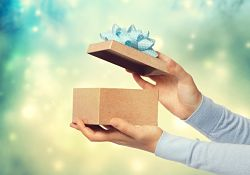 Picture of a female hand opening a gift box
