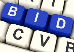 Photo of keyboard spelling out BID