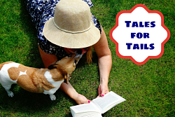 woman on grass reading to dog